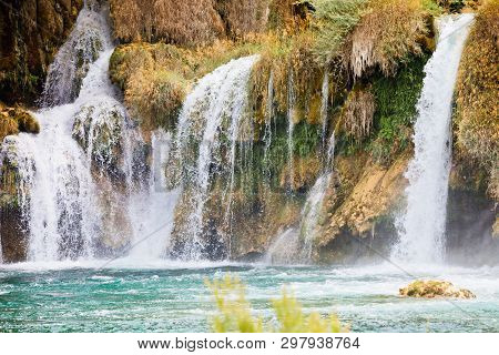 Krka, Sibenik, Croatia, Europe - Watrefall Spume Spraying Into A Cascade At Krka National Park