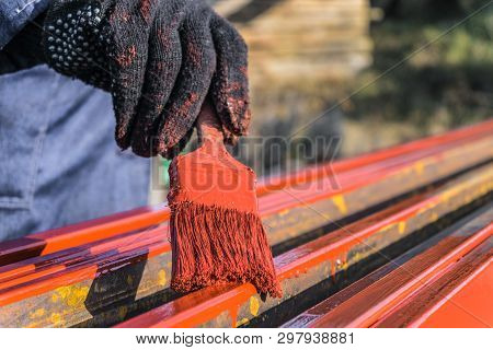 Worker Painter Covers Protective Paint Metal Structures. Protective Coating Of Steel Closed Profiles