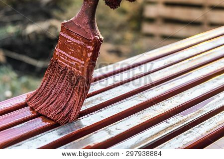 Paint Application By Brush On Metal Structures. Covering Protective Paint Metal Structures With Prim