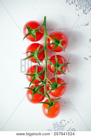 Fresh Organic Cherry Tomatoes On White Table.