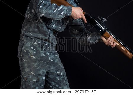 Military Or Hunter With A Shotgun. A Man Holding A Gun With A Sight. Man In Army Uniform. Soldier, T