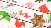 Collection of different origami models. Expositions of pupils origami objects. School origami contest. poster