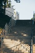 Empty concrete stairs with stainless steel handrails. poster