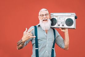 Happy Senior Man Listening To Music With Boombox Outdoor - Crazy Hipster Male Having Fun Dancing Wit