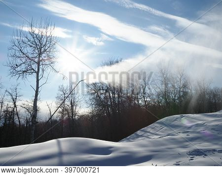 Snow Cannon. Snowmaker In Action At Ski Resort Spraying Artificial Snow With Mountains In Background