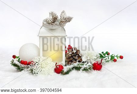 Christmas Decoration. Christmas Lantern, White Openwork Flowers Poinsettia, White Balls, Cones, Red