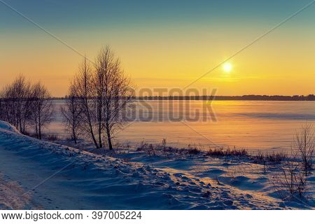 Winter Rural Landscape At Sunrise. Sunrise Over The Snowy Field