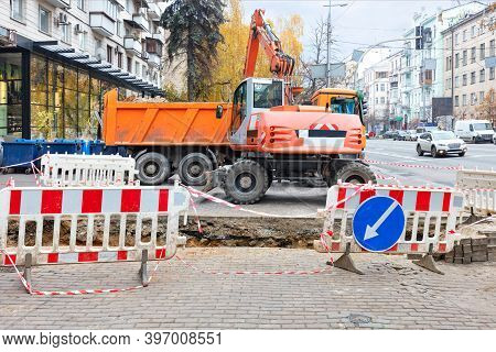 Emergency Road Vehicles, An Excavator And A Truck Are Working On The Repair Of The Heating Main, The