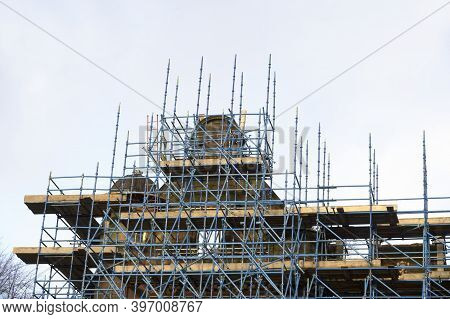 Scaffolding Surrounding House Renovation For Safe Access To Refurbishment Height