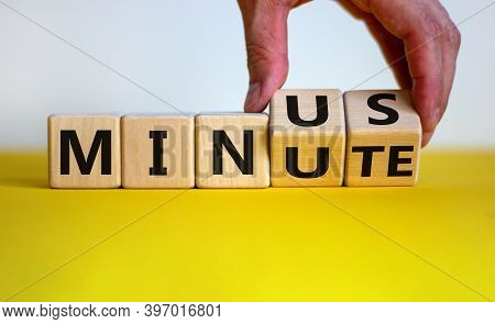 Minus Minute. Male Hand Turns Wooden Cubes And Changes The Word 'minute' To 'minus'. Beautiful Yello