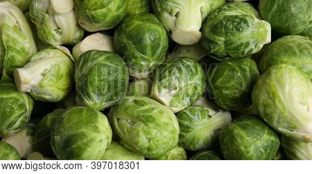 Fresh Wet Brussels Sprouts As Background, Closeup