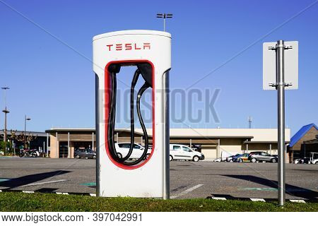 Bordeaux , Aquitaine  France - 11 21 2020 : Tesla Modern Charger Car Detail Of Supercharger Power Su