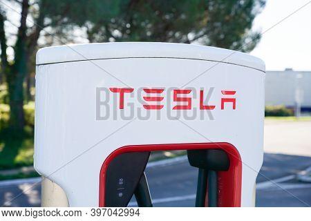 Bordeaux , Aquitaine  France - 11 21 2020 : Tesla Vehicle Charger Ev Electric Car At Supercharger Ch
