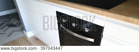 An Oven Is Installed In Kitchen Furniture Apartment. Steel Oven Integrated Wiring In Apartment. Buil