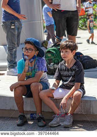 Buenos Aires, Argentina - 26 November, 2020: Children near the presidential palace on the day of farewell to Diego Maradona in Buenos Aires