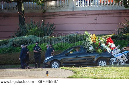 Buenos Aires, Argentina - 26 November, 2020: cortege accompanying the car with Diego Maradona's coffin in Buenos Aires