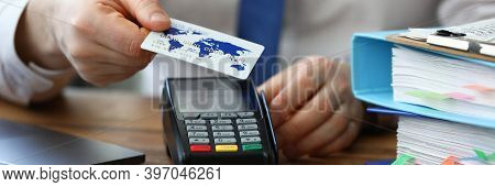 Office Employee Shows Credit Card And Terminal. Banking Application. Pos-terminal Communications Are