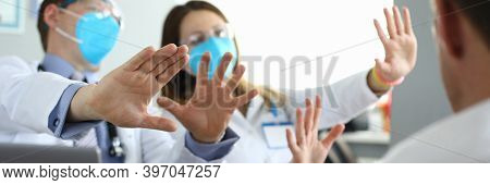 Doctors In Medical Masks Disagree With Colleagues. Patients Look At Scared Doctors Respirators. Secu