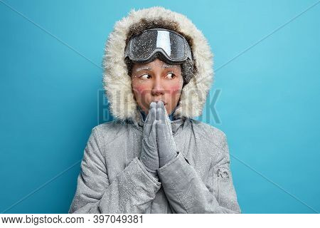 Frozen Young Ethnic Woman Tries To Warm After Spending Long Time At Cold Day Keeps Hands Pressed Tog