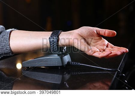 Payment For Purchase Hours Through The Terminal In The Restaurant, Shop. Womens Hand Close-up With A