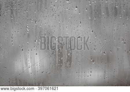 Close Up For Misted Glass With Droplets Of Water Draining Down. Dripping Condensation, Water Drops B