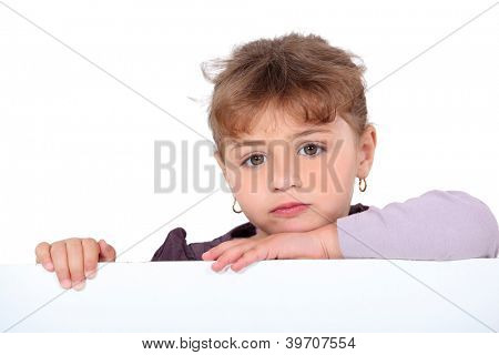 portrait of sulky schoolgirl