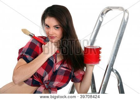 Young woman painting a room red