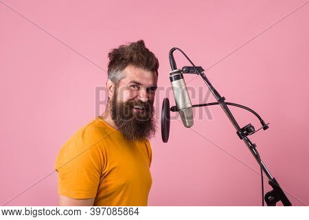 Studio Records. Bearded Man Sing In Microphone. Karaoke. Man Singing With Microphone. Singing In Stu