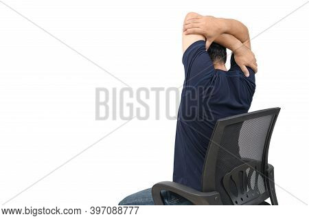 Back Side Of Man Stretching Arm To Relax Muscle Of Shoulder Blades Sitting On Chair Isolated On Whit
