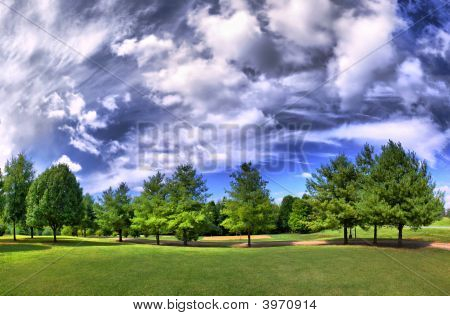 Hdr Panorama Of A Park In Summer With A Dramatic Sky