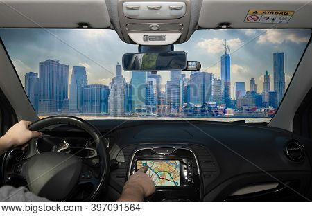 Driving A Car While Using The Touch Screen Of A Gps Navigation System The Financial District Of Manh