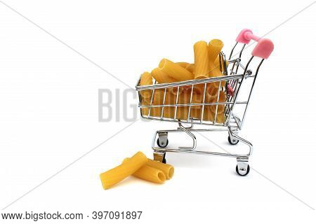 Shopping Cart With Dry Pasta In The Form Of A Tube On A White Background