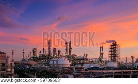 Oil And Gas Refinery Plant Or Petrochemical Industry On Sky Sunset Background, Factory With Evening,