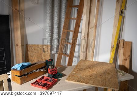 Wooden Table Top. Set Of Metal Drill Bits. A Set Of Bits For Screwing In Various Types Of Bolts And
