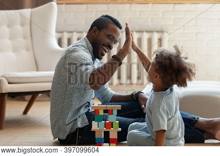 Happy Little Black Boy Giving High Five To Daddy
