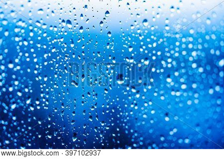Droplets Of Water On Enlighted Glass Background. Rain Water Drops Running Down. Water Droplets Falli