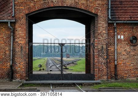 Auschwitz, Poland - July 30th 2018: The Gates And Railway Line At The Entrance To The Auschwitz Birk