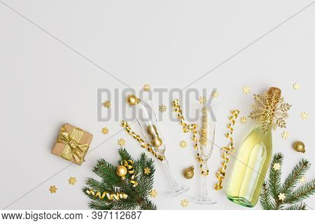 Festive Background With Gold Decoration , Bottle Of Sparkling Wine With Two Crystal Glasses, Green S