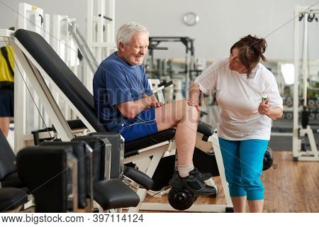 Unhappy Senior Man With Severe Pain In Knee. Stressed Elderly Man Injured Leg At Fitness Club. Sport