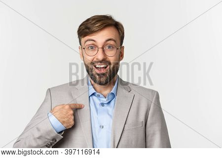 Close-up Of Surprised And Excited Office Worker In Glasses And Gray Suit, Pointing Finger At Camera