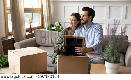 Dreamy Couple Renters Unpack Boxes At Home Visualizing