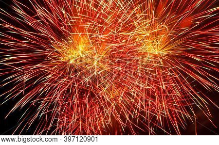 Holiday Fireworks Of Red And Golden Color On A Black Sky Background, Close Up. Copy Space
