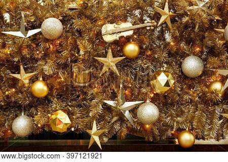 Golden Christmas Decorations With Large Details: Golden Balls, The Violin And The Stars