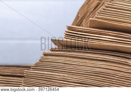 Studio Lighting. Close-up Side View Of A Huge Stack Of Recycled Paper. A Huge Stack Of Envelopes Of
