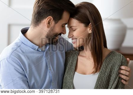 Happy Young Couple Embrace Showing Love And Affection
