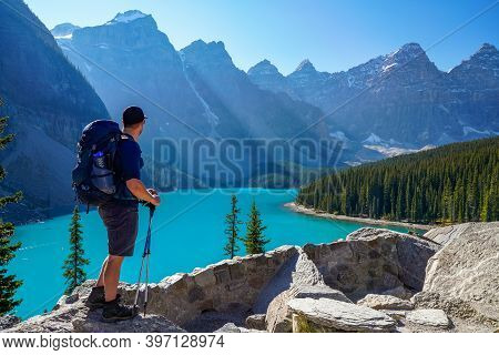 Moraine Lake Rockpile Trail In Summer Sunny Day Morning, Tourists Enjoying The Beautiful Scenery. Ba