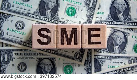 Sme Concept. Word 'sme - Small And Medium-sized Enterprises' On Cubes On A Beautiful Background From