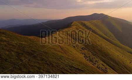 Aerial Shot Of Alps Mountains. They Flew On A Drone Over The Mountains, Rocks, Greenery, Over Rocky