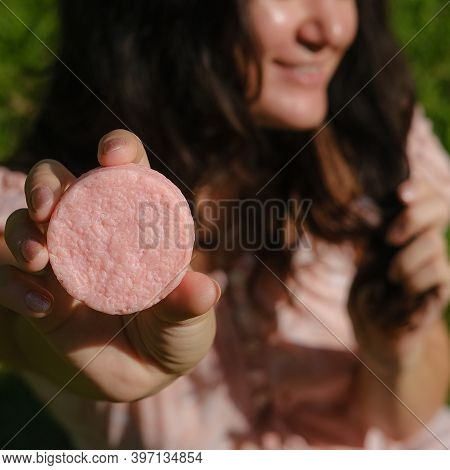 Young Woman Holding Natural Eco Friendly Solid Shampoo Bar, Conditioner Or Soap. Zero Waste And Sust