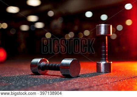 Sports Equipment In Gym. Dumbbells On The Floor. Closeup Image Of A Fitness Equipment In Gym. Gym We